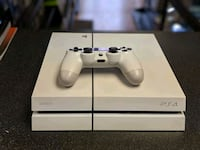 white Sony PS4 console with controller Nashville