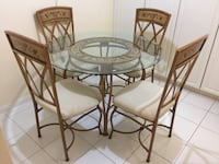 Glass Top Dining Table and four Chairs (Rod Iron)