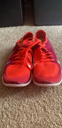 pair of red Nike running shoes 18 mi