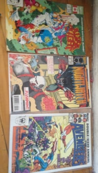 three Marvel comic books