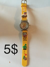 round gold analog watch with yellow strap