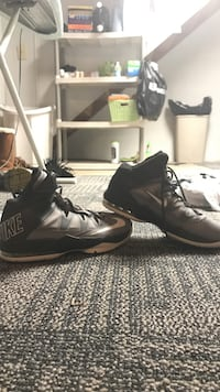 Pair of black-and-white nike basketball shoes size-8