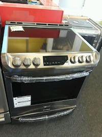 LG slide-in electric stove Brand new  Randallstown