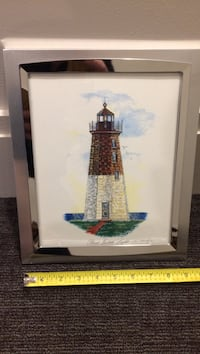 brown and gray light house painting with silver frame