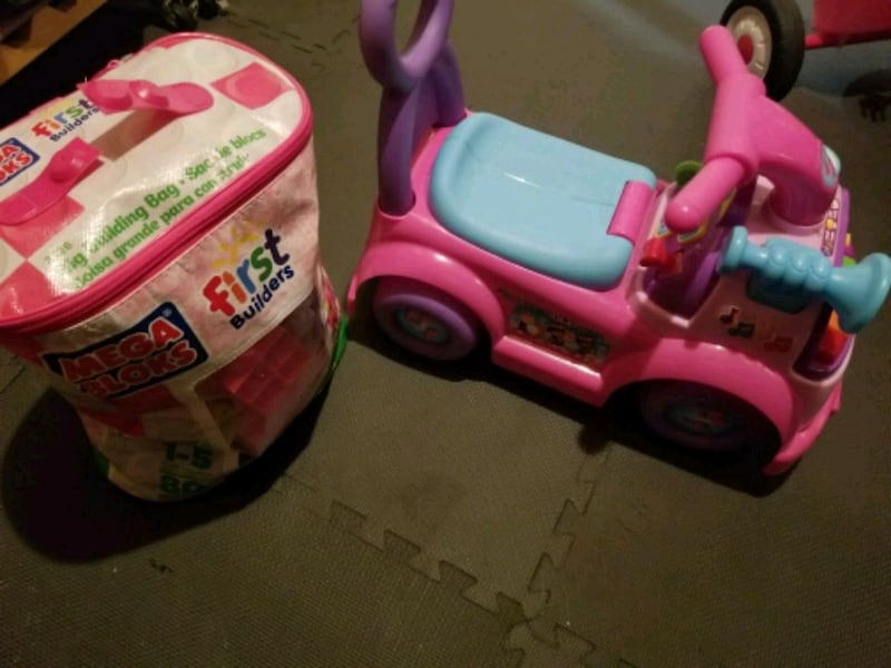 little girls car and large legos 0bb8f0e1-3789-4f06-bd9a-688976cb40c8
