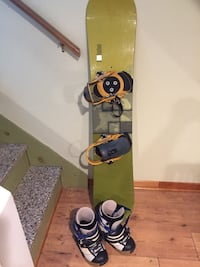 Black and yellow snowboard with bindings Montreal, H2B 1Y9