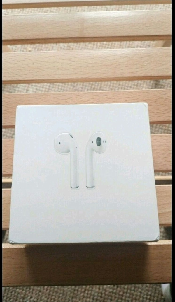 white Apple AirPods in box