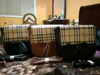 3Beautiful black and brown checked slung bag  Mississauga, L4Z 4K5