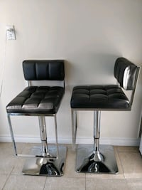 Two black leather padded chairs Toronto, M1W