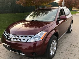 NISSAN MURANO 159k!! This Truck looks and drives great. No mechanical issues. Well maintained.