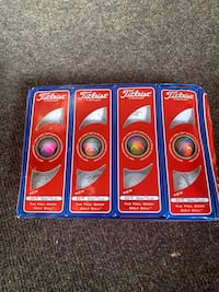 Titleist DT SO LO golf balls new in box. Sleeves numbered 1 to 4