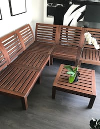 Wood patio set with black cushions