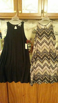 Two Brand new dresses tags still on them.
