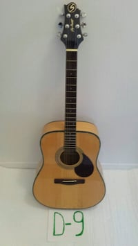 brown and black acoustic guitar Laval, H7W 3C5