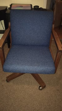 blue fabric padded brown wooden armchair 69 km