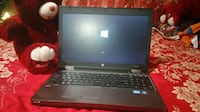 black and gray HP laptop 3121 km