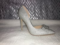 pair of silver glittered pointed toe, size 9. Manassas, 20109
