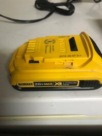 Yellow and black dewalt power tool charger