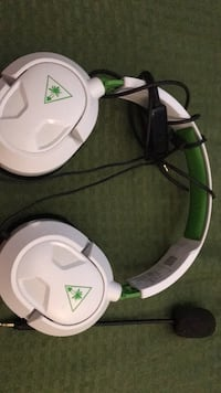 white and green corded headphones New Port Richey, 34652