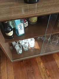 Bombay Sapphire bottle; brown wooden display cabinet New Westminster, V3L 1T6