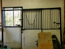 horse barn doors and hay feeders and. bars for wind