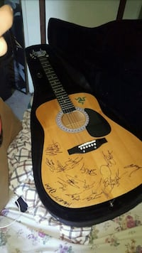 brown and black acoustic guitar Keithville, 71047