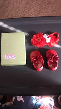 pair of red Teeny Toes shoes with box 50 km