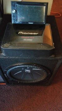 black Kicker subwoofer with enclosure and Pioneer amplifier