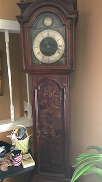 brown wooden framed pendulum clock 27 km