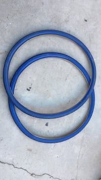 two blue bicycle wheels