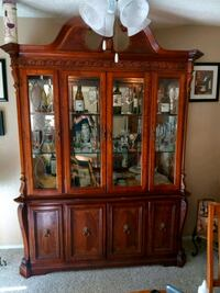 "China cabinet 7 1/2 feet tall 5 1/5 wide approx 19"" deep."