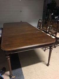 Antique extendable dining room table with 6 chairs