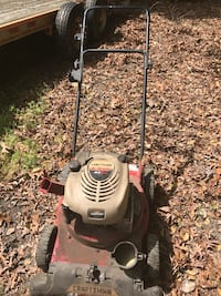 red and beige Craftsman push mower