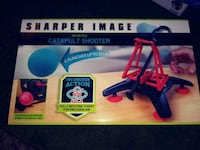 red and black Sharper Image catapult shooter box