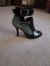 unpaired women's black and gray leather ankle-strap heeled bootie