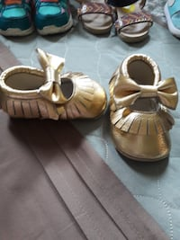 kid's pair of gold shoes