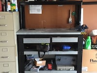 black flat screen TV with brown wooden TV hutch Myrtle Beach, 29579