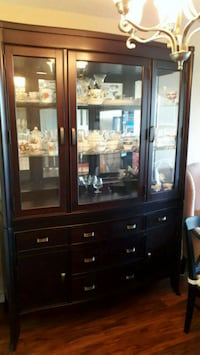 Solid Cherry wood china cabinet with 2 lights in top. Brampton, L6Y 3B1
