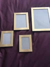 three white wooden photo frames Manchester, M14