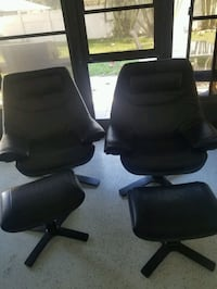 Two natuzzi re-vive chairs almost new Englewood, 34223
