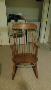 brown wooden windsor rocking chair