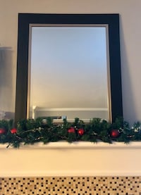 Black and silver framed mirror. All sales final, no returns. Sterling, 20164