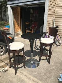two black wooden framed white padded bar stools Toronto, M4K 3K5