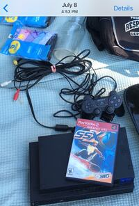 Black sony PS2 slim console with controller and game cases San Leandro, 94577