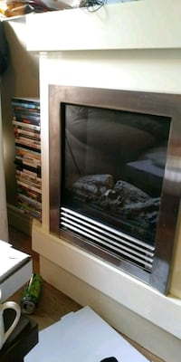 Electric fireplace heater and DVD shelf  Windsor, N9A 3A2
