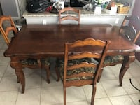 Dining room table.  6 chairs and two leaves.  It measures 7 feet long with the leaves and 5ft. 5 in without. Las Vegas, 89129