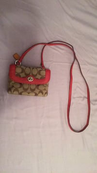 brown and pink Coach sling bag