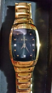 square gold analog watch with gold link bracelet Kitchener, N2A 1M7