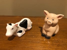 Two white and black ceramic pig figurines (salt and pepper shakers )