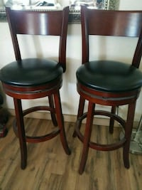 two brown wooden framed black leather padded chairs San Miguel, 93451